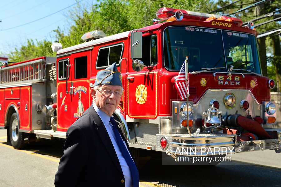 Merrick, New York, USA. 27th May 2013.  A Jewish War Veterans member (JWV) is by a Fire Engine in the Annual Memorial Day Parade 2013, with ceremony at Merrick Veteran Memorial Park.