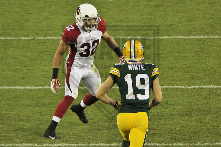 GREEN BAY - August 2013: Tyrann Mathieu (32) of the Arizona Cardinals, during a Pre-Season game against the Green Bay Packers on August 9, 2013 at Lambeau Field in Green Bay, Wisconsin. (Photo by Brad Krause)