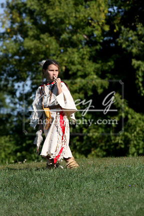 A Native American Indian girl with a bone whistle toy