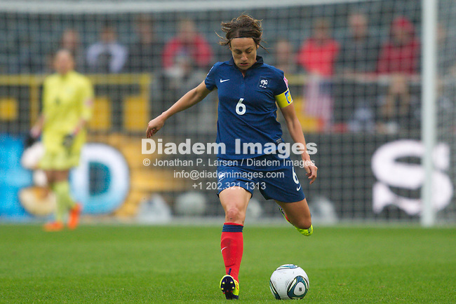 MOENCHENGLADBACH, GERMANY - JULY 13:  France team captain Sandrine Soubeyrand sets to pass the ball during a FIFA Women's World Cup semifinal soccer match against the United States at Stadion im Borussia Park on July 13, 2011  in Moenchengladbach, Germany.  Editorial use only.  Commercial use prohibited.  No push to mobile device usage.  (Photograph by Jonathan P. Larsen)