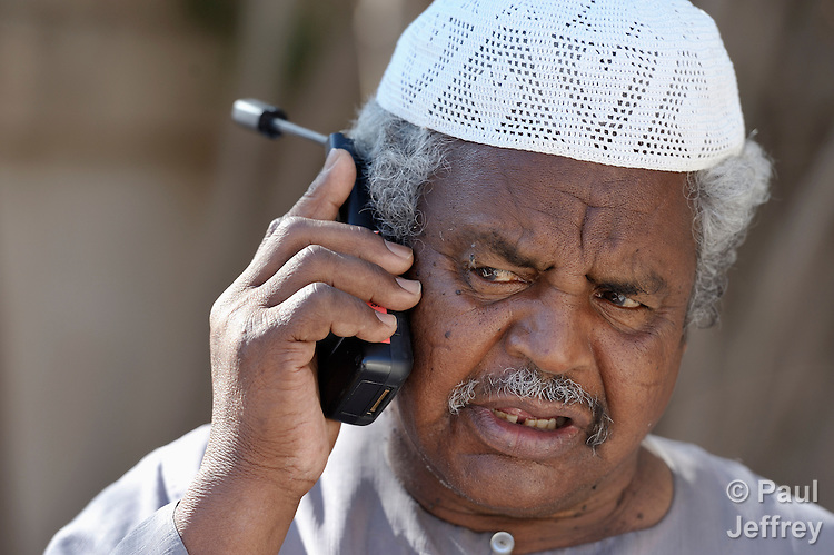 A resident of Misrata, the besieged Libyan city where civilians and rebel forces are surrounded on three sides by forces loyal to Libyan leader Moammar Gadhafi, makes contact with family outside the country using a satellite phone provided by the Libyan Red Crescent.