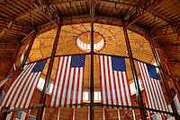 American flags hang in the train house of the Baltimore & Ohio Railroad Museum (B&O Railroad Museum) in Baltimore, Md. Many consider the museum the birthplace of American railroading. The museum offers collections and exhibits throughout its 40-acre site to educate the public about the history of trains and railroads.