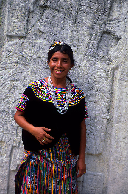 GUATEMALA, TIKAL, CARVED STELAE, LOCAL WOMAN