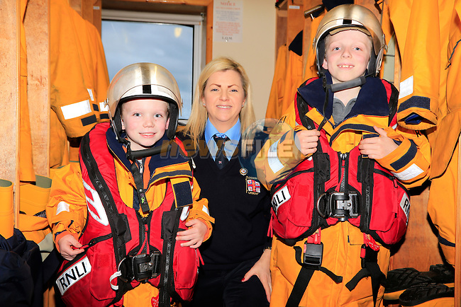 Dylan and Nathan Smith and Lisa Levins at the open day in the clogherhead lifeboat station<br /> Picture: Fran Caffrey www.newsfile.ie