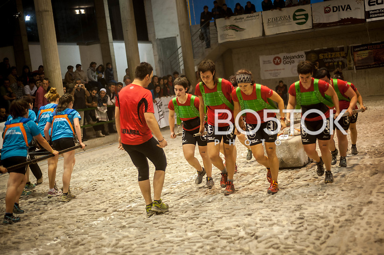 Members of Ibarra team in full effort in the human stone dragging contest in Aia (Basque Country) on May 17, 2014. This is a sport contest where a 8 persons team drag a 550 kg stone (on women's modality) across a field that measures between 22 and 28 metres. The team that completes more fields within an agreed period of time wins the contest. (Gari Garaialde / Bostok Photo)