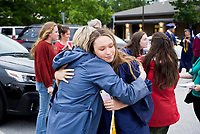 Kimberly Parker (from left) hugs her daughter Cammie Parker, Friday, May 15, 2020 during a graduation ceremony at The New School in Fayetteville. The New School celebrated its first graduation in a hybrid virtual/in-person ceremony. <br /> <br /> The senior class consisted of 11 students. The ceremony was conducted outdoors where graduates and their families, the only guests in attendance outside of essential faculty and staff, were restricted to spaces within safe social distances to view pre-recorded programming and to allow graduates to accept their diplomas one at a time. Check out nwaonline.com/200516Daily/ for today's photo gallery. <br /> (NWA Democrat-Gazette/Charlie Kaijo)