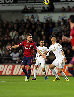 Sunday, 28 November 2012<br /> Pictured: Ki Sung Yueng of Swansea (R) against James Morrison of West Bromwich Albion<br /> Re: Barclays Premier League, Swansea City FC v West Bromwich Albion at the Liberty Stadium, south Wales.