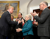 United States President Donald J. Trump, left, speaks with US Representative Virginia Foxx (Republican of North Carolina), Chair of the US House Education and Workforce Committee, center, and US Representative Greg Walden (Republican of Oregon), Chair of the US House Energy &amp; Commerce Committee, right, prior to signing an Executive Order to promote healthcare choice and competition in the Roosevelt Room of the White House in Washington, DC on Thursday, October 12, 2017.  The President's controversial plan is designed to make lower-premium health insurance plans more widely available.<br /> Credit: Ron Sachs / Pool via CNP /MediaPunch