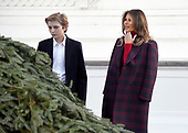 First lady Melania Trump and son Barron accept the White House Christmas tree on the North Portico of the White House in Washington, DC on Monday, November 20, 2017.  The tree will stand in the Blue Room.<br /> Credit: Ron Sachs / CNP
