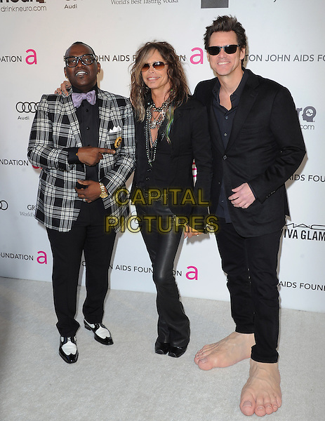 Randy Jackson, Steven Tyler (of Aerosmith) & Jim Carrey.The 21st Annual Elton John AIDS Foundation Academy Awards Viewing Party held at The City of West Hollywood Park in West Hollywood, California, USA..February 24th, 2013.oscars full length grey gray check suit jacket leather trousers scarf necklace sunglasses shades funny giant large oversized feet make-up prosthetics .CAP/DVS.©DVS/Capital Pictures.