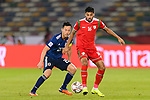 Yoshida Maya of Japan (L) fights for the ball with Muhsen Al Ghassani of Oman (R) during the AFC Asian Cup UAE 2019 Group F match between Oman (OMA) and Japan (JPN) at Zayed Sports City Stadium on 13 January 2019 in Abu Dhabi, United Arab Emirates. Photo by Marcio Rodrigo Machado / Power Sport Images