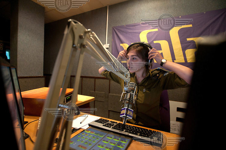 An Israeli soldier broadcasts on Galgalatz an Israeli military radio station that broadcasts music and traffic reports.