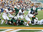 Rice Owls defensive tackle Hosam Shahin (57), Rice Owls linebacker Justin Allen (31) and Rice Owls defensive lineman Brian Stacey (69) in action during the game between the Rice Owls and the Baylor Bears at the Floyd Casey Stadium in Waco, Texas. Baylor defeats Rice 56 to 31.
