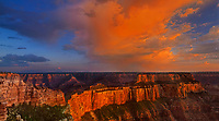 935000010 panoramic view - cloud formations and a light mist are the remnants of a clearing summer storm over the canyon formations in this view from the north rim lodge at grand canyon national park arizona
