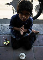 Child begging in Pattaya, Thailand.