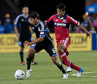 Santa Clara, California - Saturday July 28, 2012: Chicago Fire's Pavel Pardo attacking San Jose Earthquakes' Shea Salinas during a game at Buck Shaw Stadium, Stanford, Ca    San Jose Earthquakes and Chicago Fire tied 0 - 0