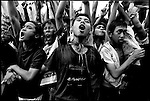 Summer '99-- Jakarta, Indonesia -- People cheer at a rally for GUS DUR.
