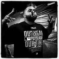 SAN FRANCISCO, CA - OCTOBER 7: Instagram of San Francisco Giants slugger Pablo Sandoval smoking a victory cigar in the clubhouse after winning Game 4 of the NLDS against the Washington Nationals at AT&T Park on October 7, 2014 in San Francisco, California. Photo by Brad Mangin