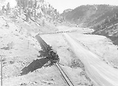 K-36 #487 and K-36 #482 double-headed westbound toward Monero with 33 mixed freight cars.  Photographer above train.<br /> Amargo Canyon, NM  Taken by Richardson, Robert W. - 11/6/1949