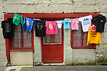 A colourful display of Fleadh clothing on sale in Chapel lane ahead of the official opening of the All-Ireland Fleadh 2017 in Ennis. Photograph by John Kelly.