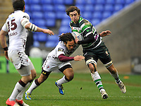 READING, ENGLAND : Alex Gray of London Irish tackled during the Amlin Challenge Cup match between London Irish and Bordeaux-Begles at Madejski Stadium on January 18, 2013 in Reading, England.
