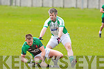 Na Gaeil's Eamon O'Neill and Churchill's Daniel Doyle in action in the division 4 game in Tralee on Sunday.