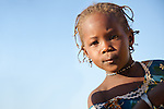 Fulani girl in the seasonal village of Bantagiri in northern Burkina Faso.  The Fulani are traditionally nomadic pastoralists, crisscrossing the Sahel season after season in search of fresh water and green pastures for their cattle and other livestock.