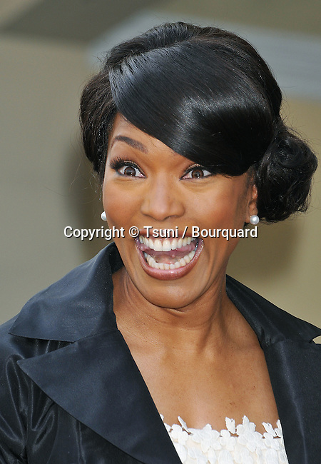 Angela Bassett Honored with a Star on the Hollywood Walk Of Fame In Los Angeles.<br /> <br /> headshot<br /> three quarters<br /> full length<br /> eye contact<br /> smile