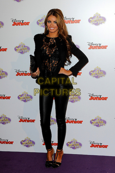 Chloe Sims.The launch of the Disney TV Series 'Sofia The First' at the Mayfair Hotel, London, England..22nd February 2013.full length  black blazer hand on hip crochet bra leather trousers see through thru clutch bag.CAP/CJ.©Chris Joseph/Capital Pictures.