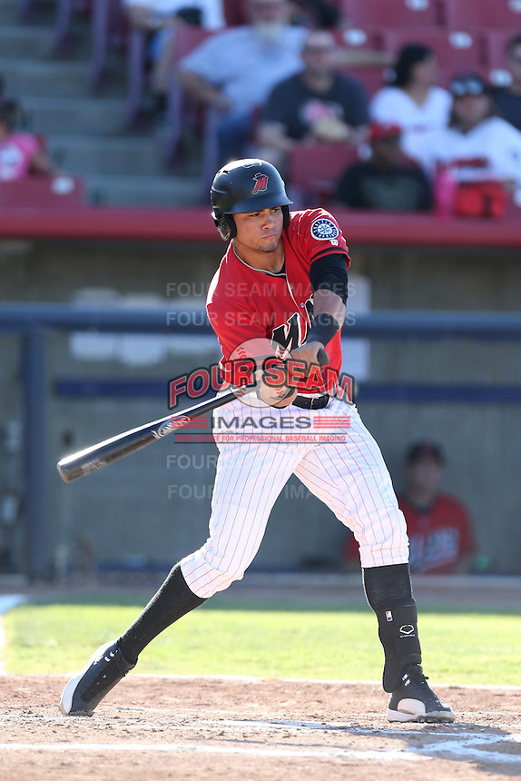Jody Lara #7 of the High Desert Mavericks bats against the Modesto Nuts at Heritage Field on June 29, 2014 in Adelanto, California. High Desert defeated Modesto, 6-1. (Larry Goren/Four Seam Images)