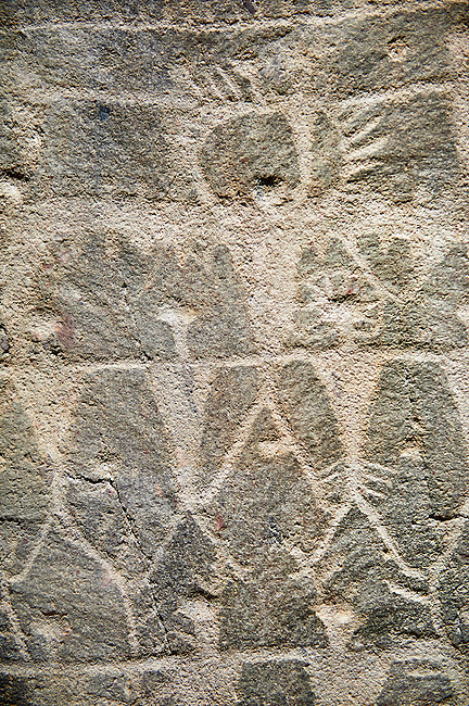 """Prehistoric  petroglyphs, rock carvings, of schematic figures carved by the the prehistoric Camuni people in the Copper Age around the 3rd milleneum BC, Stele """"Cemmo 3"""" found in 1981 from the prehistoric sanctuary Massi dei Cemmo Archaeological Site. Museo Nazionale della Preistoria della Valle Camonica ( National Museum of Prehistory in Valle Cominca ), Lombardy, Italy."""