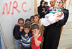 Za'atari Refugee Camp, Mafraq Governorate, Jordan, March 5th, 2014 : Polio vaccination teams fan through Za'Atari syrian refugee camp during the mass immunization campaign taking place in five countries bordering Syria. There are around 90,000 refugees in Za'atari, with 14,000 children to immunize.<br /> Mafraq Governorate covers one fifth of Jordan and border Syria, Iraq and Saudi Arabia. It has a population of 306,000 jordanians plus 400,000 syrian refugees, and a total of 56,000 children under five are being immunized during the campaign. (Photo by Jean-Marc Giboux)
