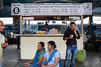 Passengers make calls and drink chai during a 15 minute stop at Nagpur station, Maharashtra...Train passengers on the Himsagar Express 6318 going from Jammu Tawi station to Kanyakumari on 8th July 2009.. .6318 / Himsagar Express, India's longest single train journey, spanning 3720 kms, going from the mountains (Hima) to the seas (Sagar), from Jammu and Kashmir state of the Indian Himalayas to Kanyakumari, which is the southern most tip of India...Photo by Suzanne Lee / for The National