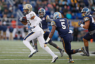 Annapolis, MD - December 28, 2015:     Pittsburgh Panthers wide receiver Tyler Boyd (23) avoids the tackle of  Navy Midshipmen cornerback Quincy Adams (5) during the Military Bowl game between Pitt vs Navy at Navy-Marine Corps Memorial Stadium in Annapolis, MD. (Photo by Elliott Brown/Media Images International)