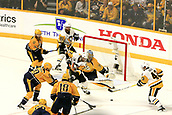 June 5th 2017, Nashiville, TN, USA;  Pittsburgh Penguins center Matt Cullen (7) and Pittsburgh Penguins left wing Conor Sheary (43) try to gain control of the loose puck in front of Nashville Predators goalie Pekka Rinne (35) during Game 4 of the Stanley Cup Final between the Nashville Predators and the Pittsburgh Penguins, held on June 5, 2017, at Bridgestone Arena in Nashville, Tennessee.