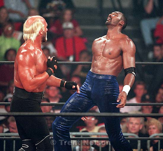 Karl Malone and Hollywood Hulk Hogan wrestle at WCW's Bash at the Beach.<br />