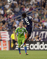 New England Revolution defender Emmanuel Osei (5) with difficult header. The New England Revolution defeated the Seattle Sounders FC, 3-1, at Gillette Stadium on September 4, 2010.
