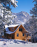 A winter scene with a log cabin as the focus in the Rocky Mountains at Estes Park, Colorado, USA