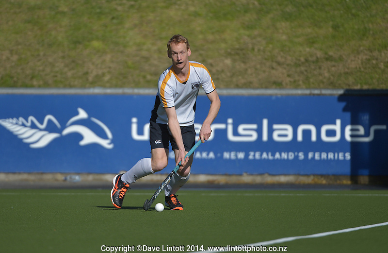Action from the Wellington Premier Two men's hockey match between Kapiti 1 (purple) and Harbour City 2 (white) at National Hockey Stadium, Wellington, New Zealand on Sunday, 17 August 2014. Photo: Dave Lintott / lintottphoto.co.nz