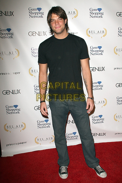 BRIAN DROLET .1st Annual Film Festival held at a Bel Air Private Estate, Bel Air, California, USA, 14 November 2008..full length black t-shirt jeans trainers converse .CAP/ADM/KB.©Kevan Brooks/Admedia/Capital PIctures