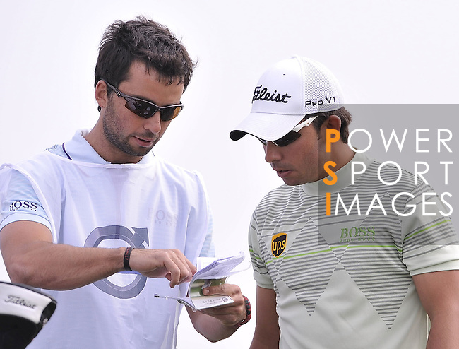 SUZHOU, CHINA - APRIL 17:  Pablo Larrazabal (R) of Spain listen his caddie and brother Alejandro Larrazabal on the 16th tee during the Round Three of the Volvo China Open on April 17, 2010 in Suzhou, China. Photo by Victor Fraile / The Power of Sport Images