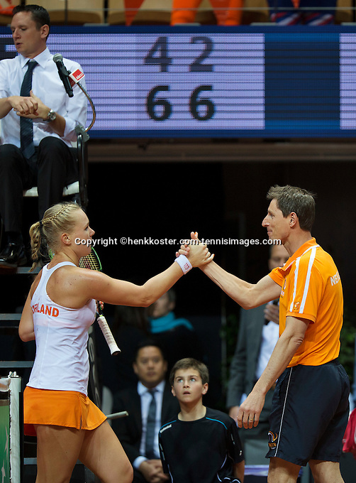 Arena Loire,  Trélazé,  France, 16 April, 2016, Semifinal FedCup, France-Netherlands, First match: Kiki Bertens vs Caroline Garcia, Kiki Bertens (NED), Photo: Kiki Bertens is congratulated by captain Paul Haarhuis after making the first point for the Netherlands<br /> <br /> Photo: Henk Koster/Tennisimages