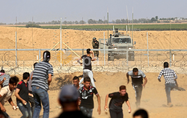 """Israeli security forces use tear gas to disperse Palestinian protestors on the 21st Friday of """"Great March of Return"""" demonstration near Israel-Gaza border, in Khan Yunis, Gaza on August 17, 2018. Photo by Ashraf Amra"""