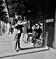 Men waiting for the Third Avenue elevated train in the Fifties at 8:30 a.m., New York, New York. September 1942.<br /> <br /> Photo by Marjorie Collins.