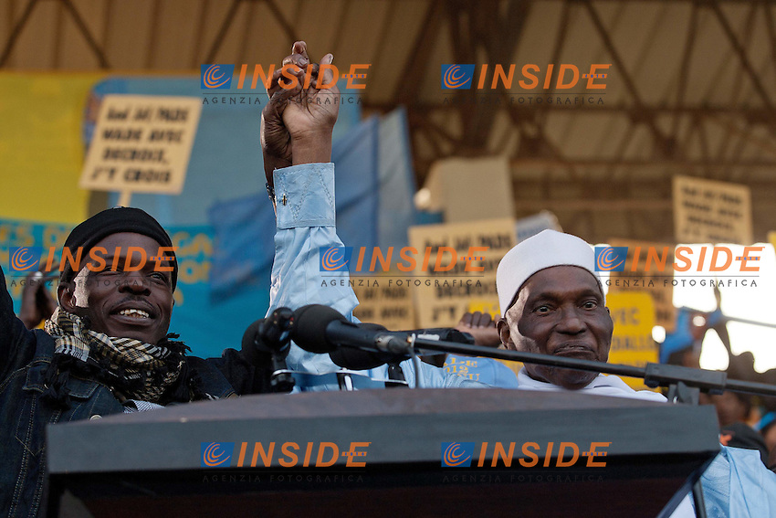 President Abdoullah Wade reaches the speaker's podium to start his speech in front of hundreds of supporters that gathered to cheer him in Pikine, outskirt of Dakar, 22 Feb. 2012. Photo Insidefoto / Giulio Petrocco / Anatomica Press .ITALY ONLY