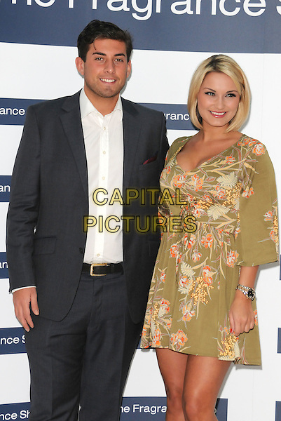 """James """"Arg"""" Argent & Sam Faiers.Make An Appearance To Promote Their Fragrances """"Be Reem"""" And """"Dazzle"""" At The Fragrance Shop, Bluewater Shopping Centre, Greenhithe, Kent, UK 31st March 2012..perfume launch photocall TOWIE half length suit green floral print khaki dress  white shirt grey gray .CAP/BRC.©Ben Rector/Capital Pictures."""