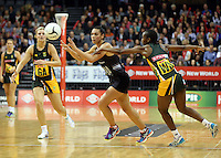 26.07.2015 Silver Ferns Grace Rasmussen and South Africa's Precious Mthembu in action during the Silver Fern v South Africa netball test match played at Claudelands Arena in Hamilton. Mandatory Photo Credit ©Michael Bradley.