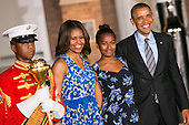 First Lady Michelle Obama, left center, daughter Sasha Obama, right center, and United States President Barack Obama, right, attend the Marine Barracks Washington, D.C. Evening Parade in Washington, D.C., on Friday, June 27, 2014. <br /> Credit: Kristoffer Tripplaar  / Pool via CNP