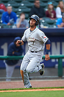 San Antonio Missions first baseman Luis Domoromo (7) scores a run during a game against the NW Arkansas Naturals on May 30, 2015 at Arvest Ballpark in Springdale, Arkansas.  San Antonio defeated NW Arkansas 5-1.  (Mike Janes/Four Seam Images)