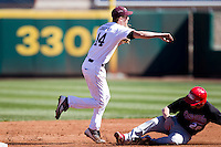 Eric Cheray (14) of the Missouri State Bears turns a double play during a game against the Southern Illinois University- Edwardsville Cougars at  Hammons Field on March 10, 2012 in Springfield, Missouri. (David Welker / Four Seam Images)